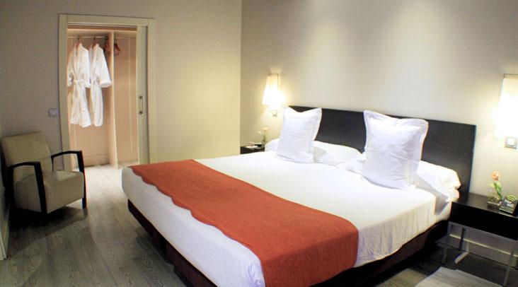 Dormitorio Suite Ejecutiva Familiar Sercotel Suites Viena